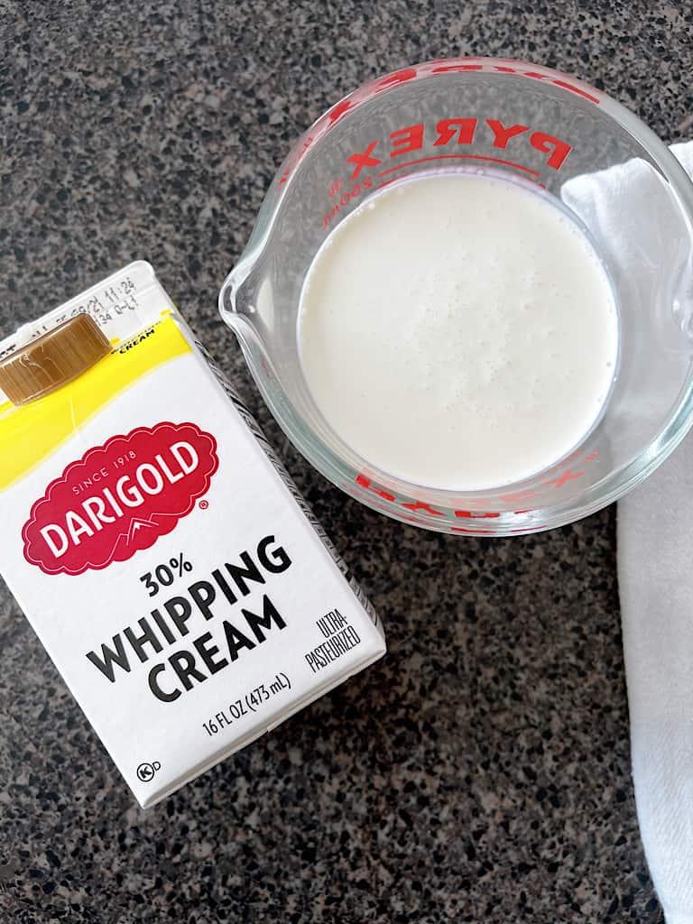 A carton of heavy whipping cream.