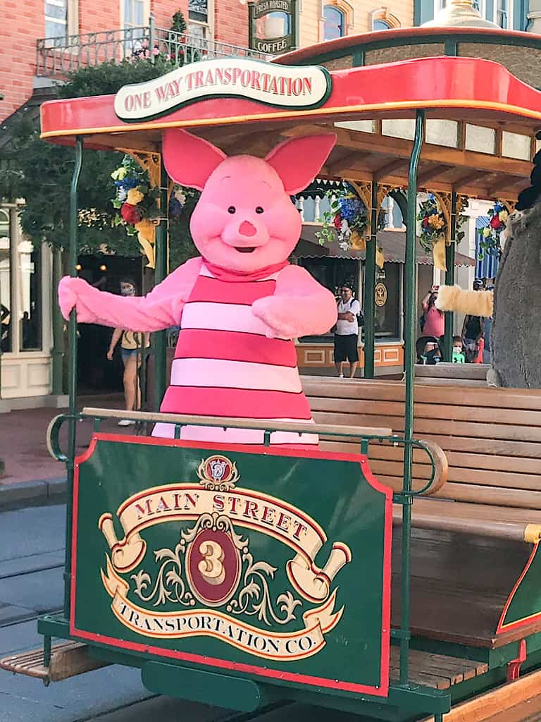 Piglet from Winnie the Pooh riding on a trolley car at Disney's Magic Kingdom.