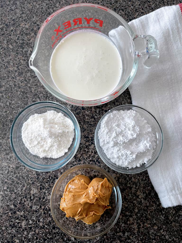 Heavy whipping cream, instant pudding mix, powdered sugar, and peanut butter to make Peanut Butter Whipped Cream.