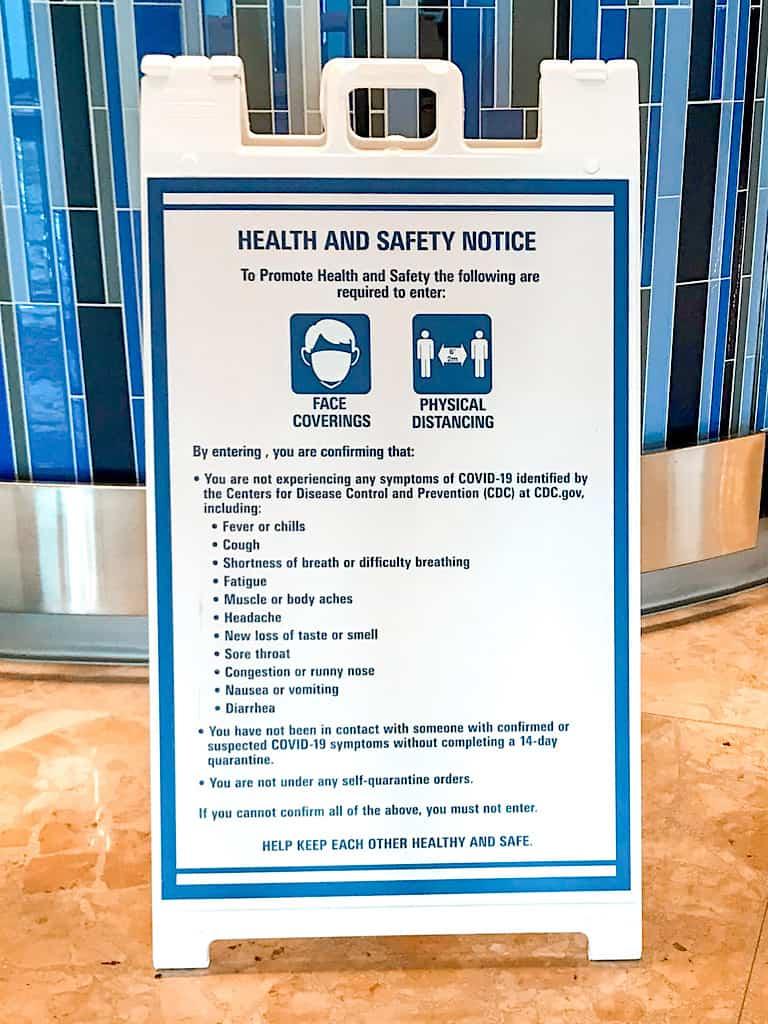 Face Mask and Social Distancing sign at Disney World.