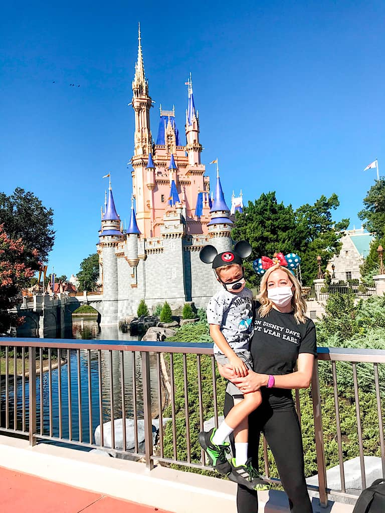 A mom and little boy in front of Cinderella Castle at Disney World.