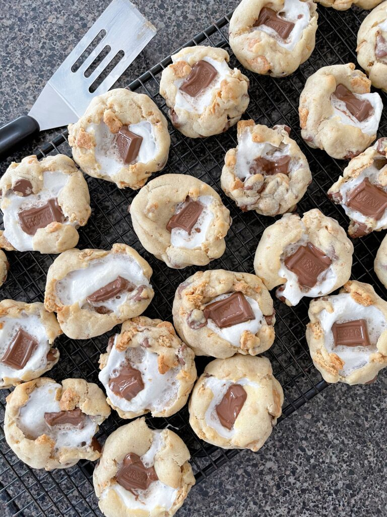 S'mores Cookies with Graham Crackers on a cooling rack.