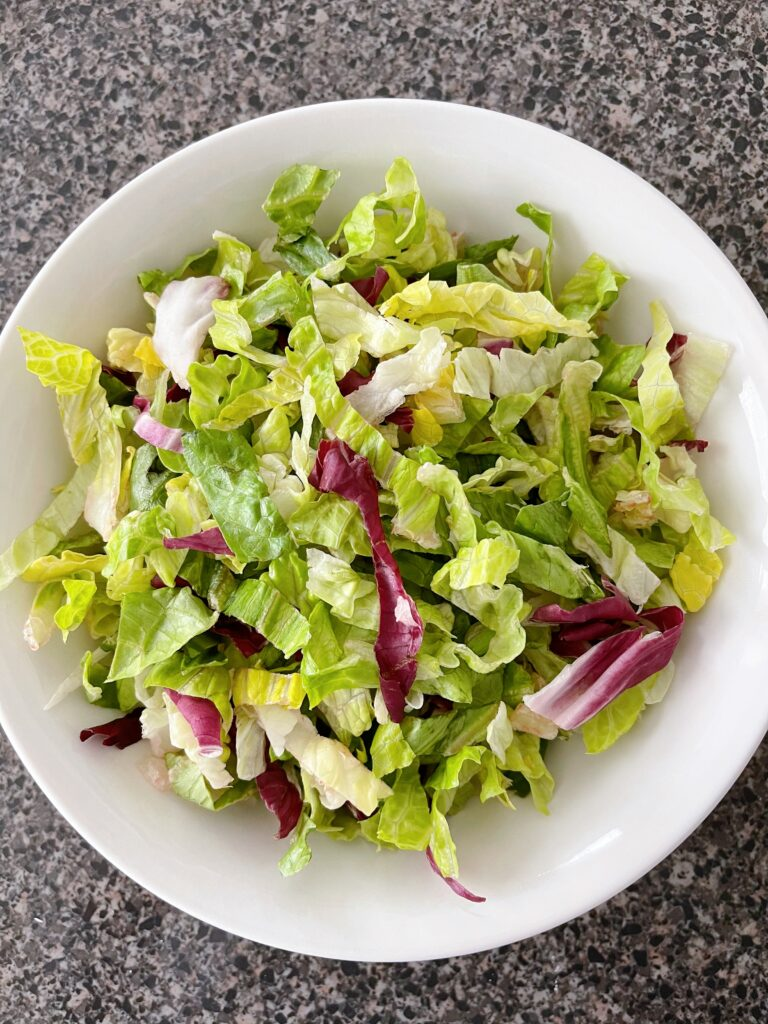 A bowl of chopped romaine lettuce.
