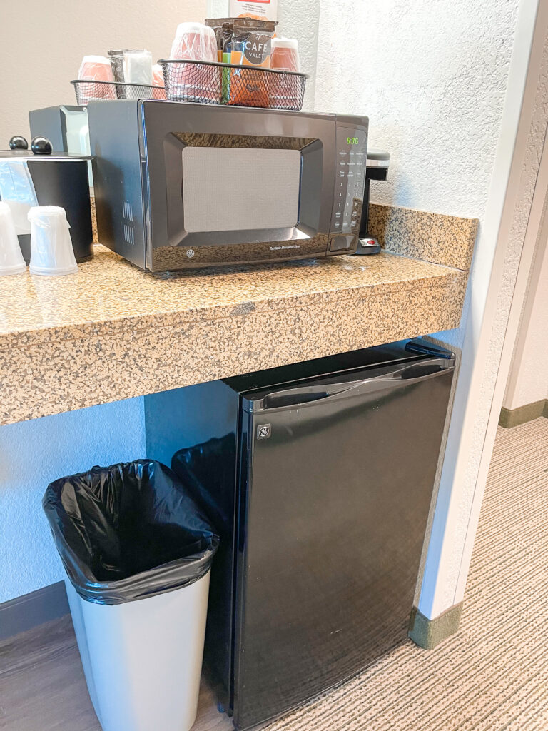 Microwave, coffee maker, and small refrigerator in a Grizzly Bear Suite.