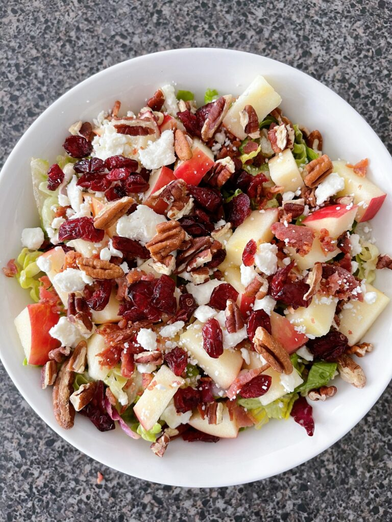 A bowl of apple salad.