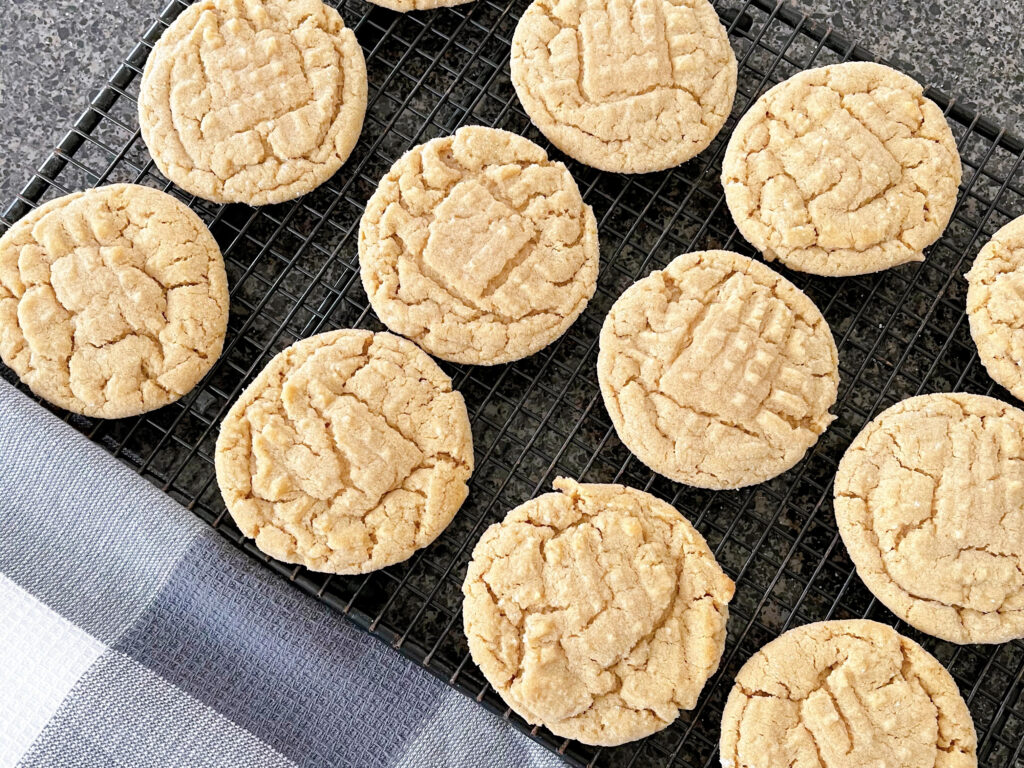 Peanut butter cookies on a cooling rack.