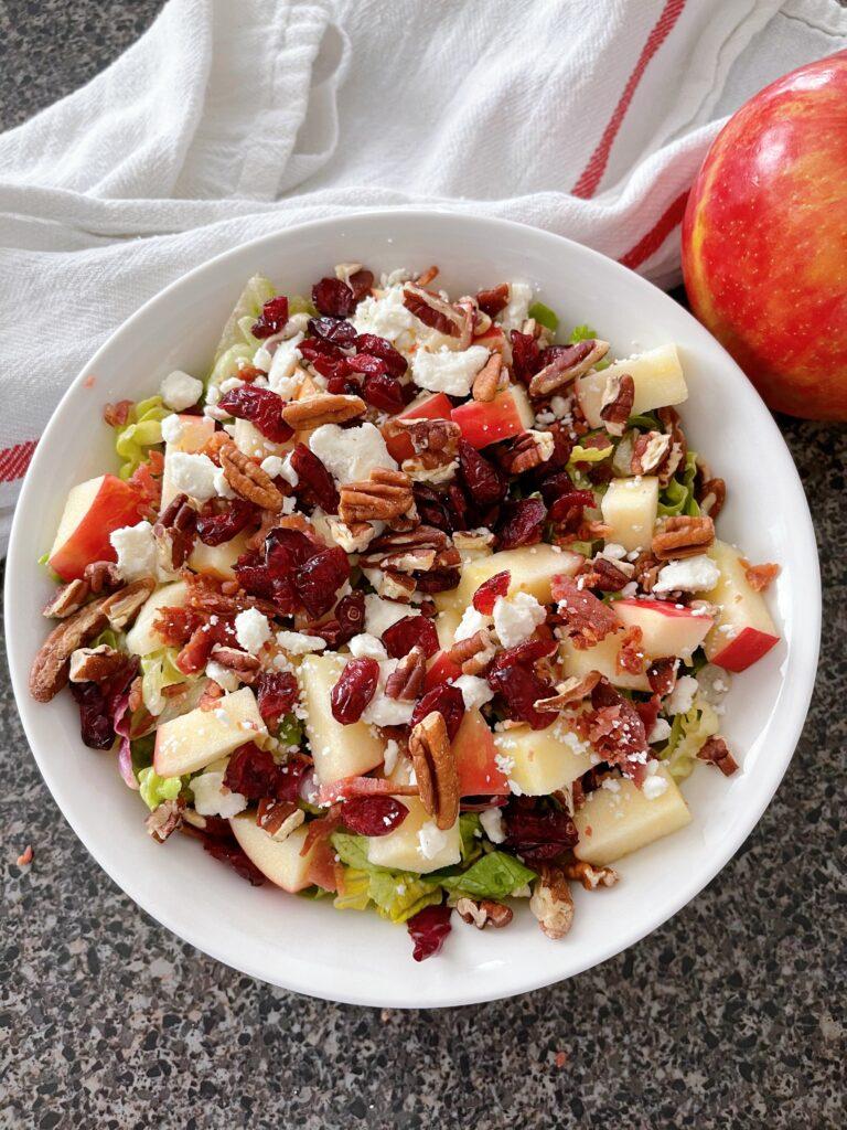 A bowl filled with Honeycrisp Harvest Salad.