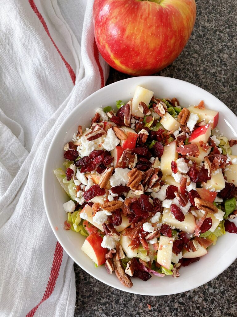 Honeycrisp apple salad with a white towel and an apple.