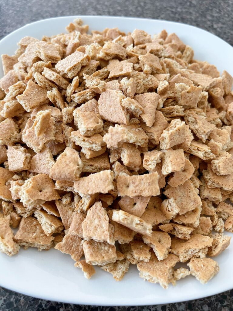 A plate of graham cracker pieces.