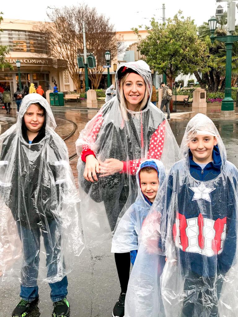 A family wearing ponchos at Disneyland.