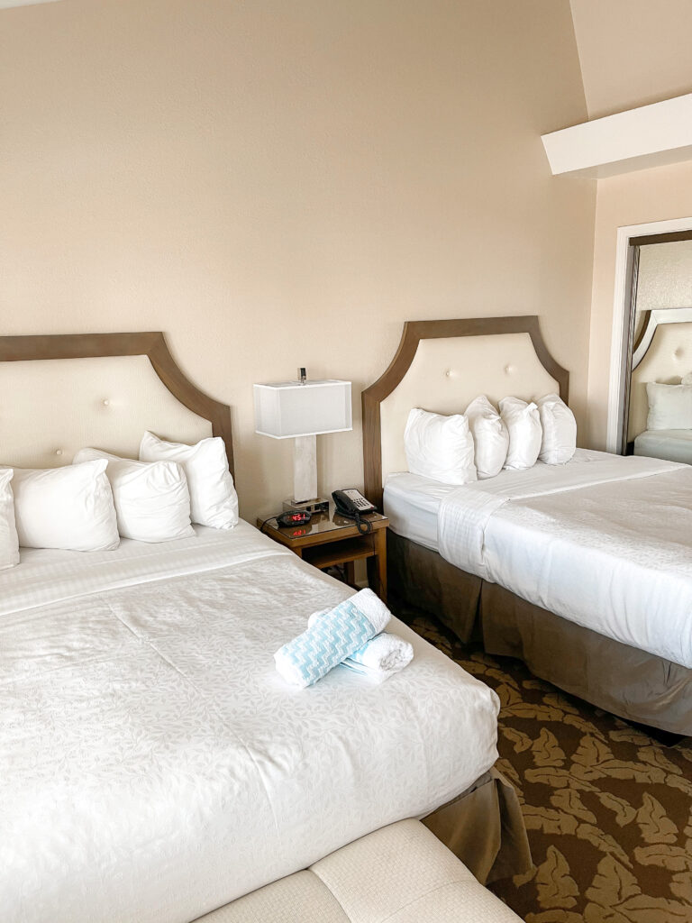 Two queen beds and a closet in Best Western Island Palms Hotel.