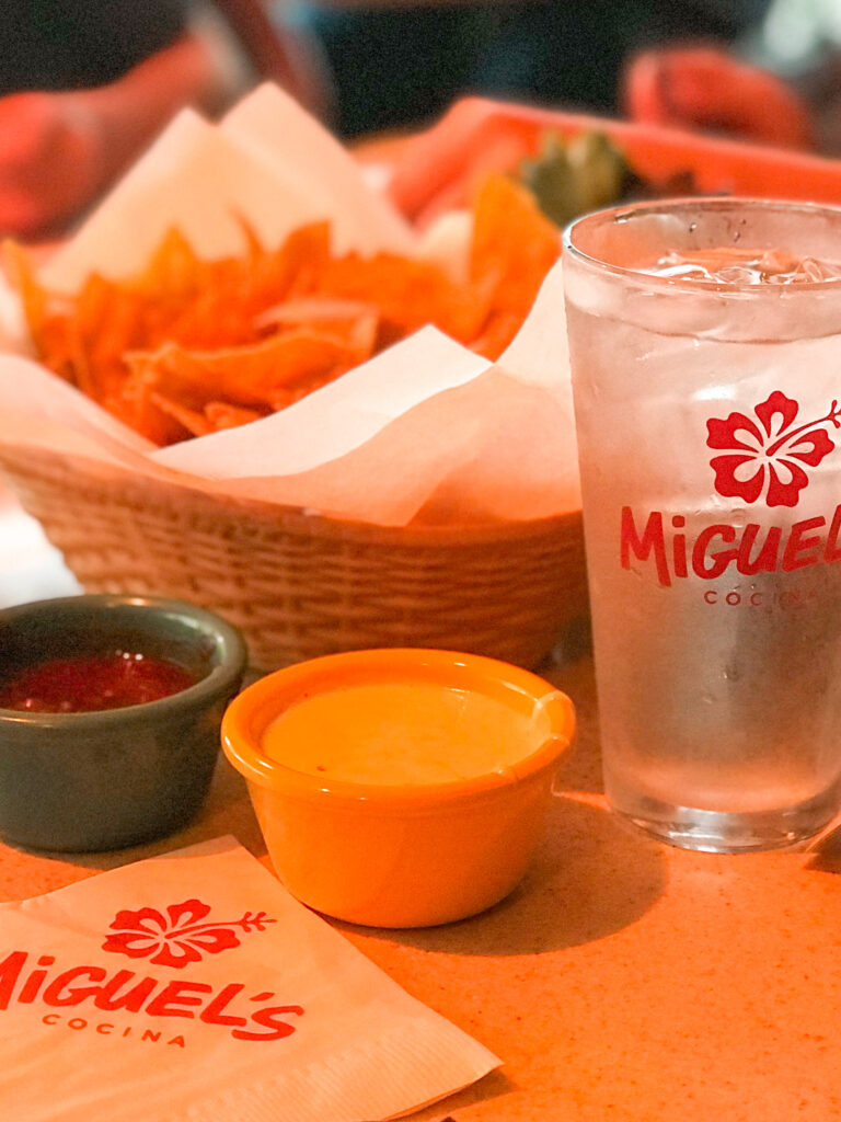 Chips, salsa, queso dip, and a glass of water at Miguel's Cocina in San Diego.