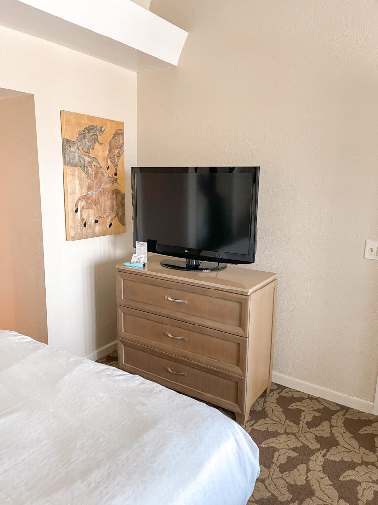 Dresser and TV in guest room at Best Western Island Palms.
