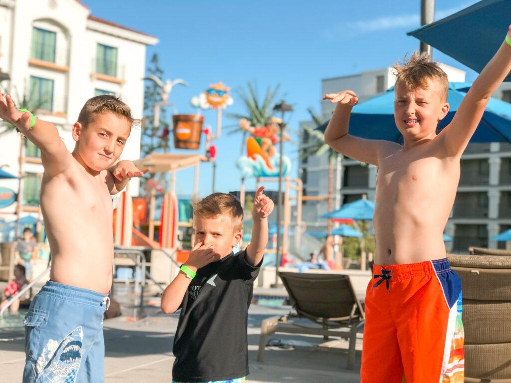 Three kids at Surfside Waterpark at Courtyard Anaheim Theme Park Entrance.