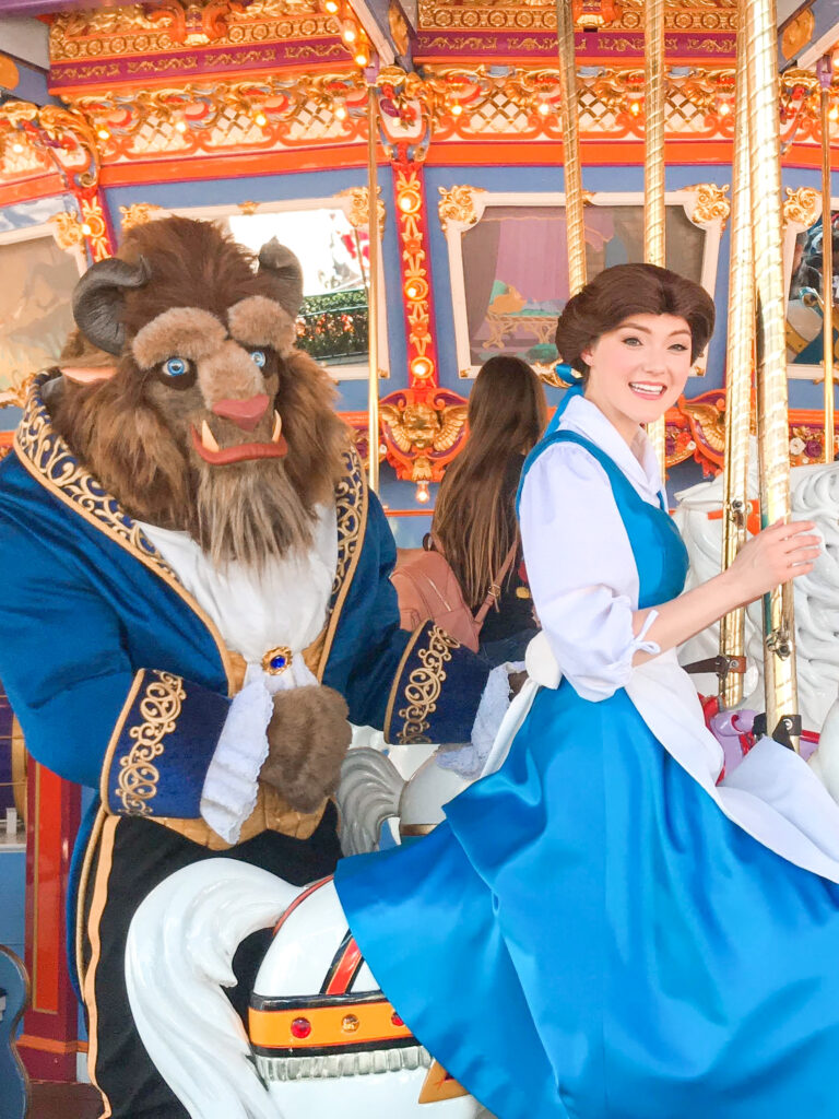 Belle and the Beast on a carousel at Disneyland.
