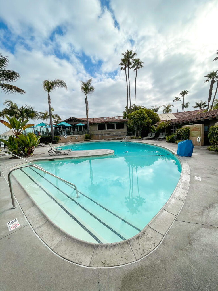 Swimming pool with palm trees at Best Western Island Palms Hotel.