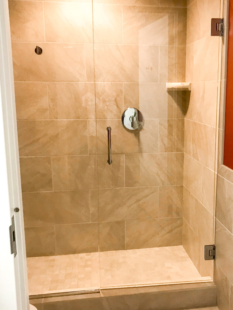 Stand up shower inside a guest room at Courtyard Anaheim Theme Park Entrance.