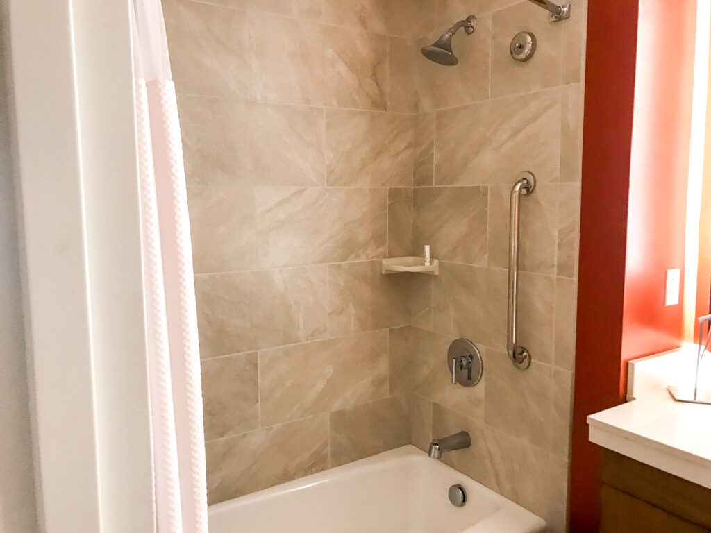 Shower tub combination in a guest room at Courtyard Anaheim Theme Park Entrance.