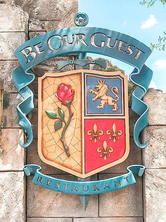 Sign for Be Our Guest restaurant at Disney World.