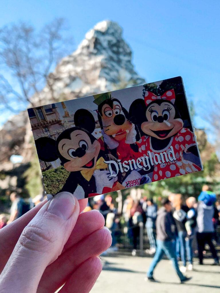 Disneyland ticket in front of Matterhorn Boblseds.