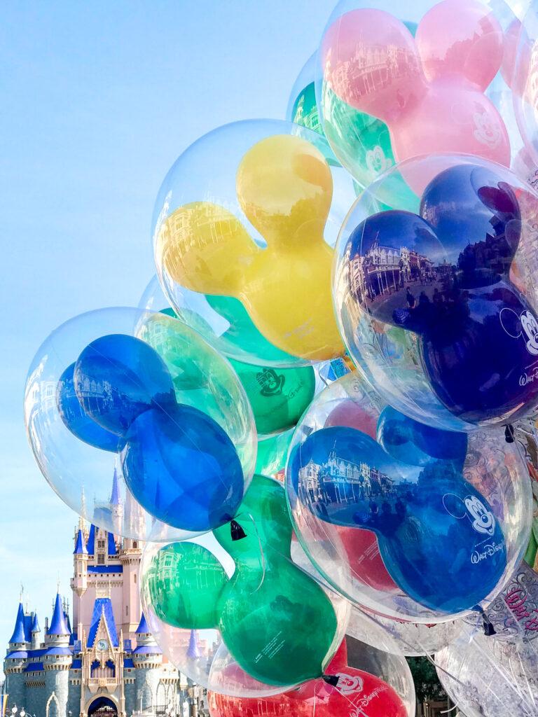 Mickey balloons outside Cinderella's Castle.