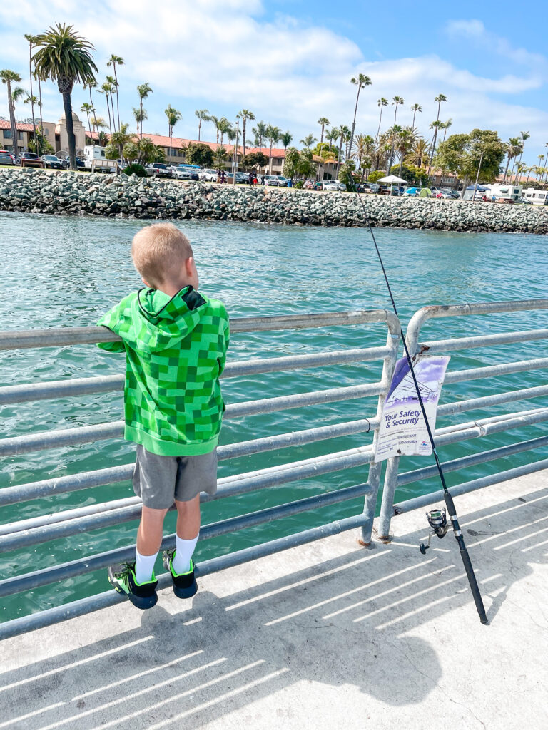 A boy fishing on the Shelter Island Pier.