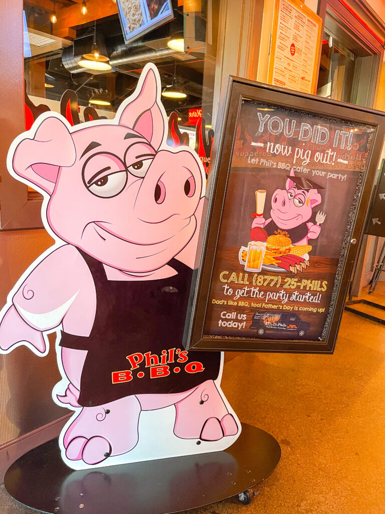 A sign with a pig advertising Phil's BBQ in San Diego.