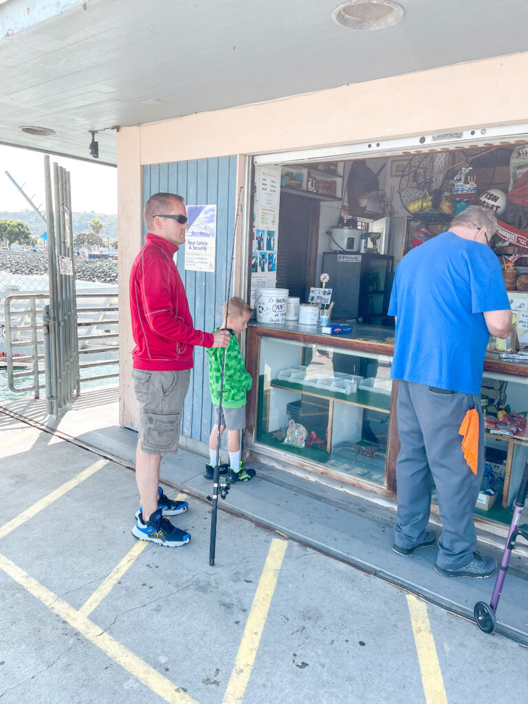 People renting fishing poles on Shelter Island pier.