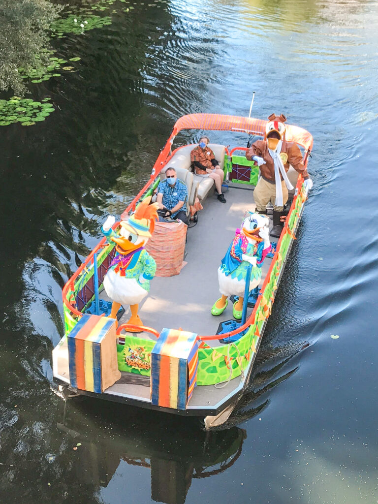Donald Duck, Daisy Duck, and Launch Pad in a cavalcade boat at Animal Kingdom.