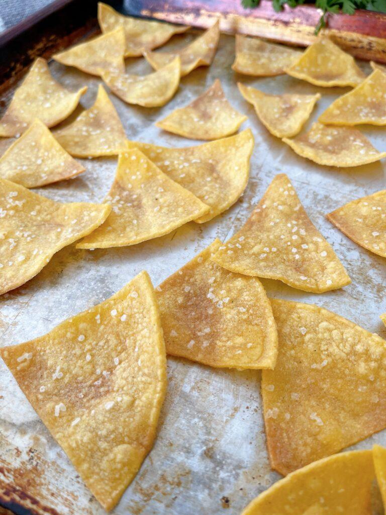 A pan of baked tortilla chips.