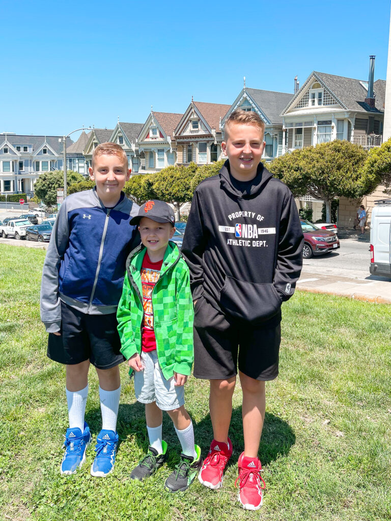 Three kids in front of the Painted Ladies in San Francisco.