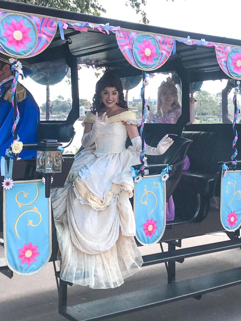 Disney princesses in a car at Epcot.