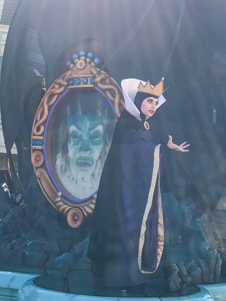 The Evil Queen from Snow White in a cavalcade at Magic Kingdom.