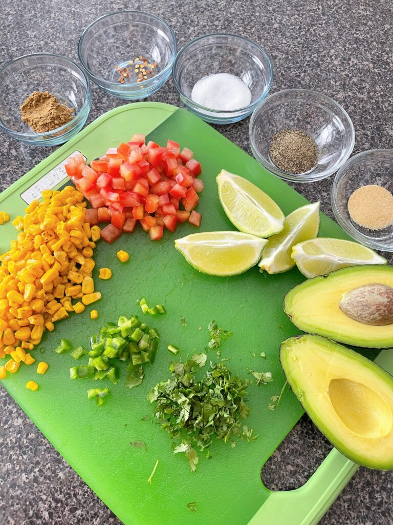 Ingredients to make chunky guacamole.