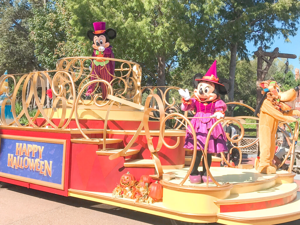 Mickey, Minnie, and Pluto on a Happy Halloween float.