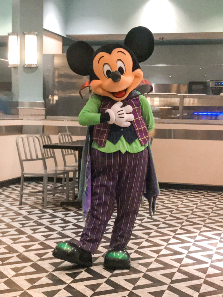 Mickey Mouse dressed as a vampire at Disney World.