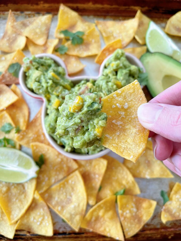 A chip topped with chunky guacamole.