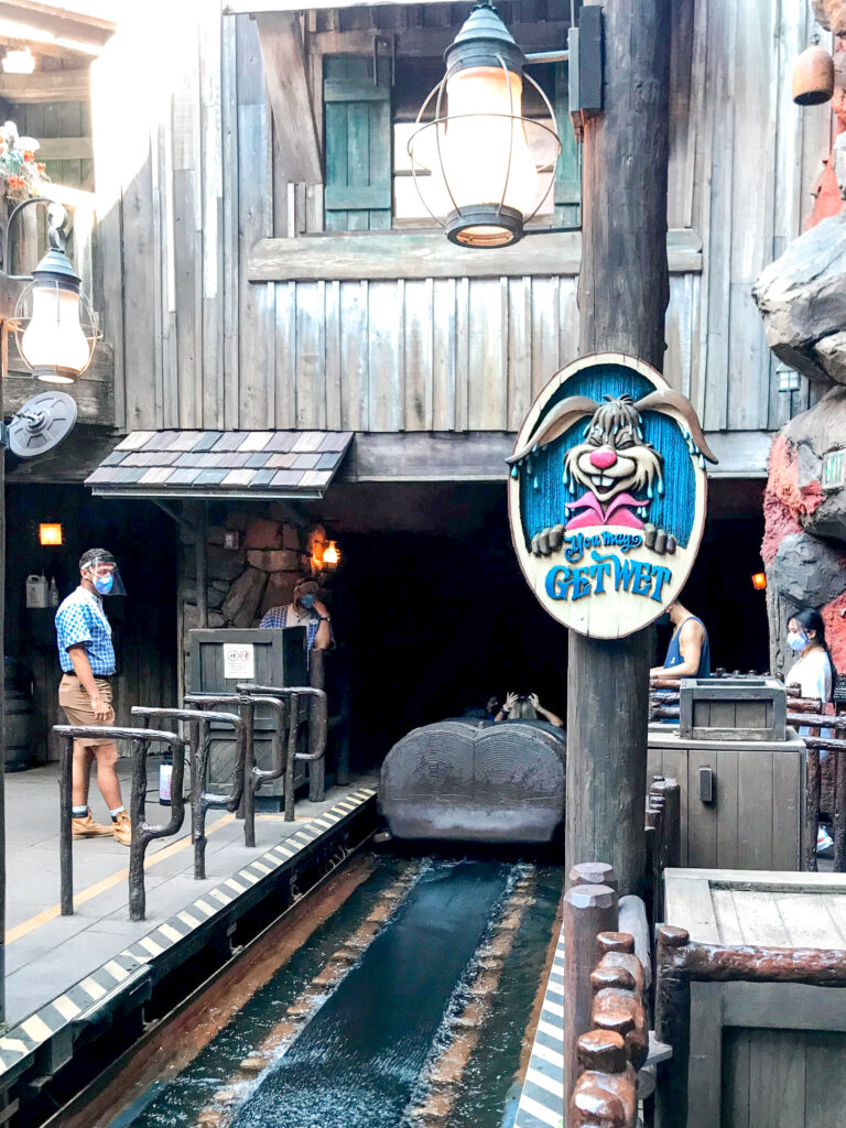 """Beginning of Splash Mountain and a sign that says """"You May Get Wet""""."""