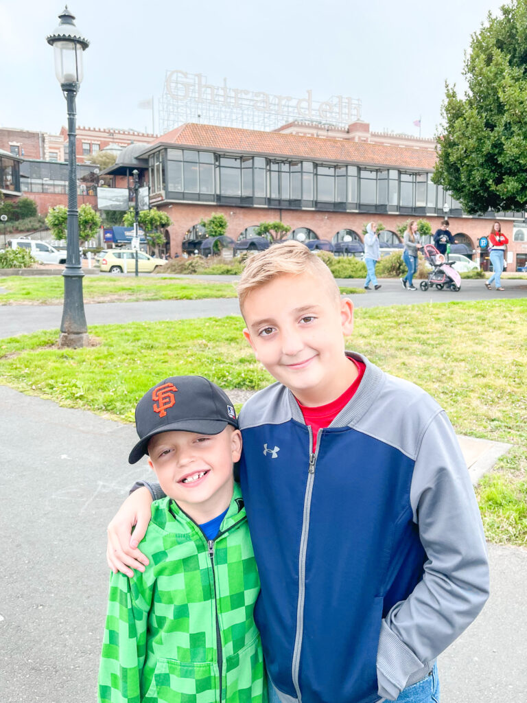 Two boys in front of Ghirardelli Square.