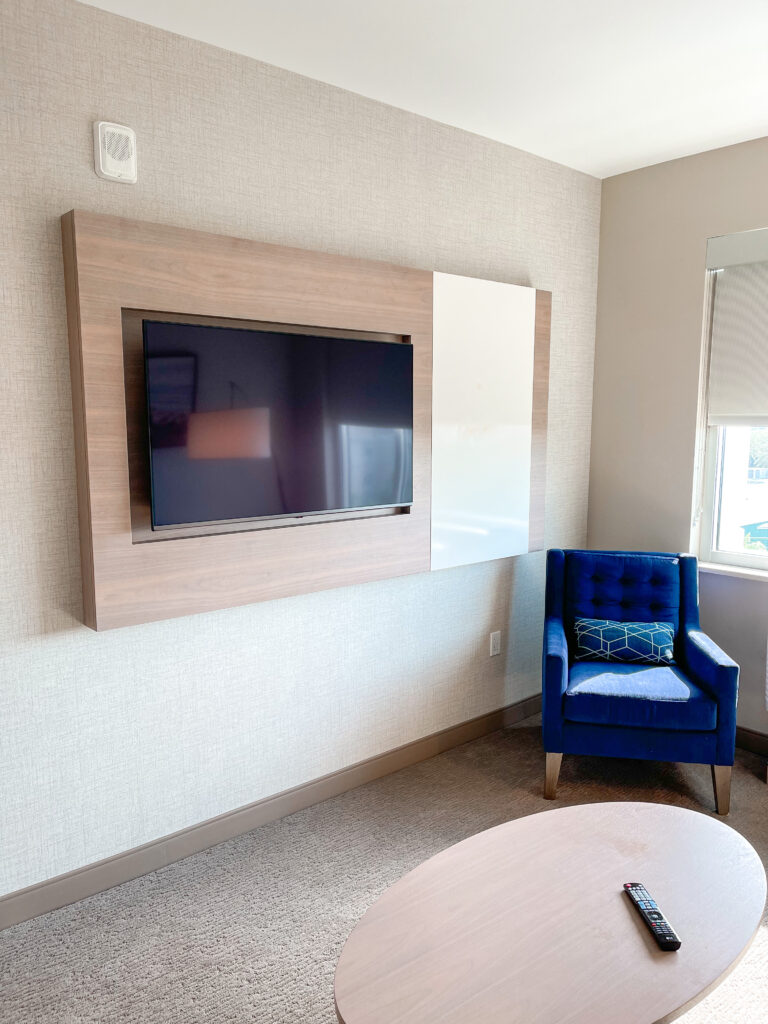 Chair and television in the living room of a kids suite.