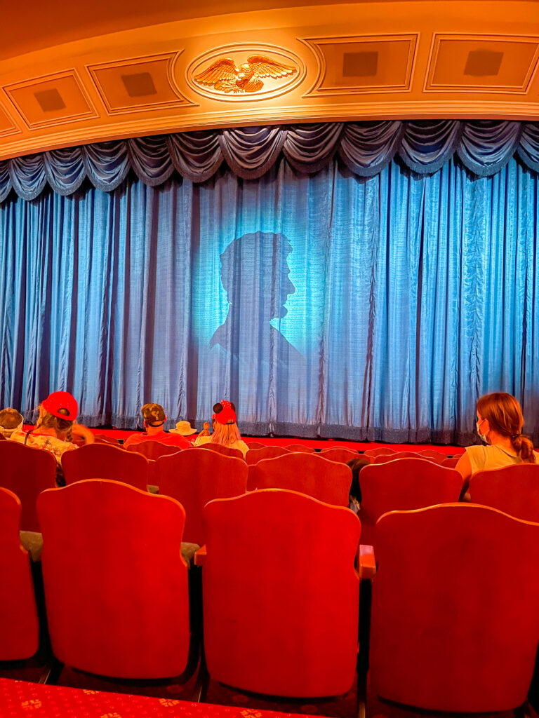 Abraham Lincoln's silhouette on a curtain as part of the Great Moments with Mr. Lincoln show at Disneyland.