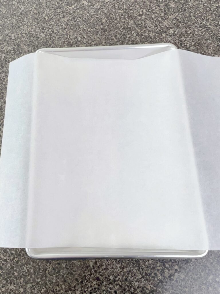 Parchment paper lining a baking sheet.