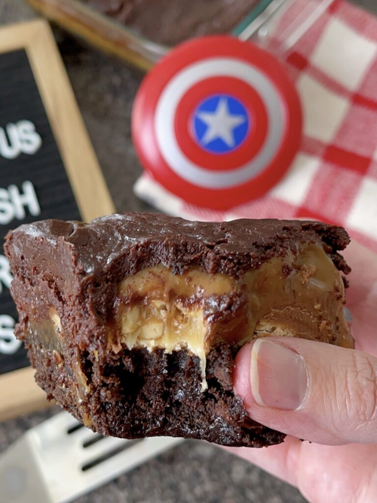 A close up view of the layers in Snickers brownies.