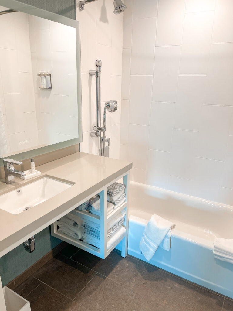 Bathroom with two showers at Cambria in Anaheim.