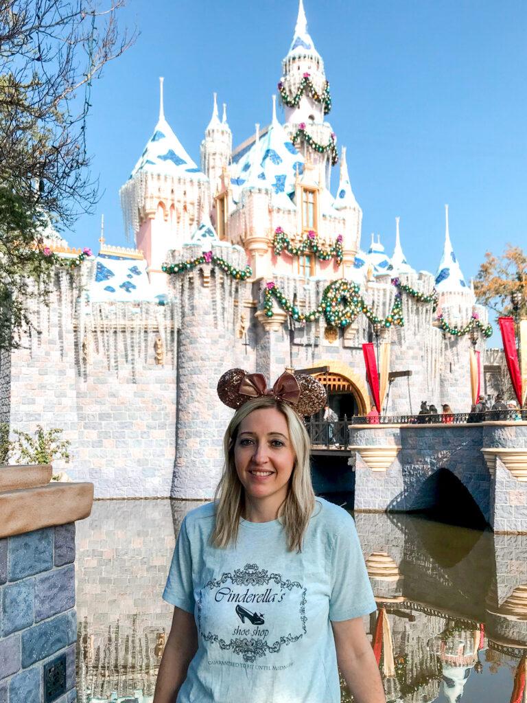 A girl in front of Sleeping Beauty Castle.