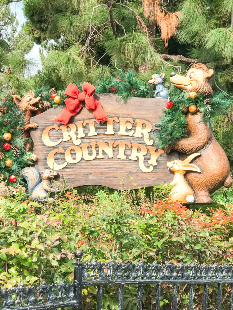 Sign for Critter Country at Disneyland decorated for Christmas.