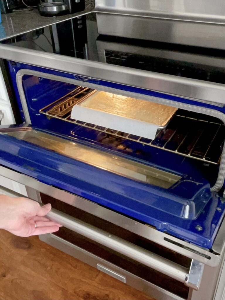 Cream cheese sugar cookie bars in an oven.