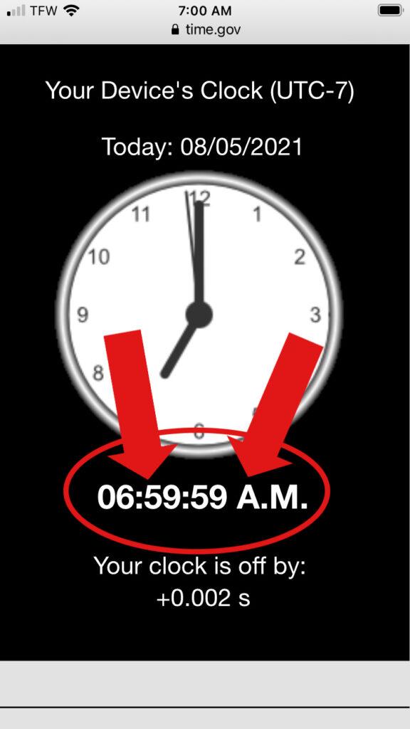 A clock showing 06:59:59 am.