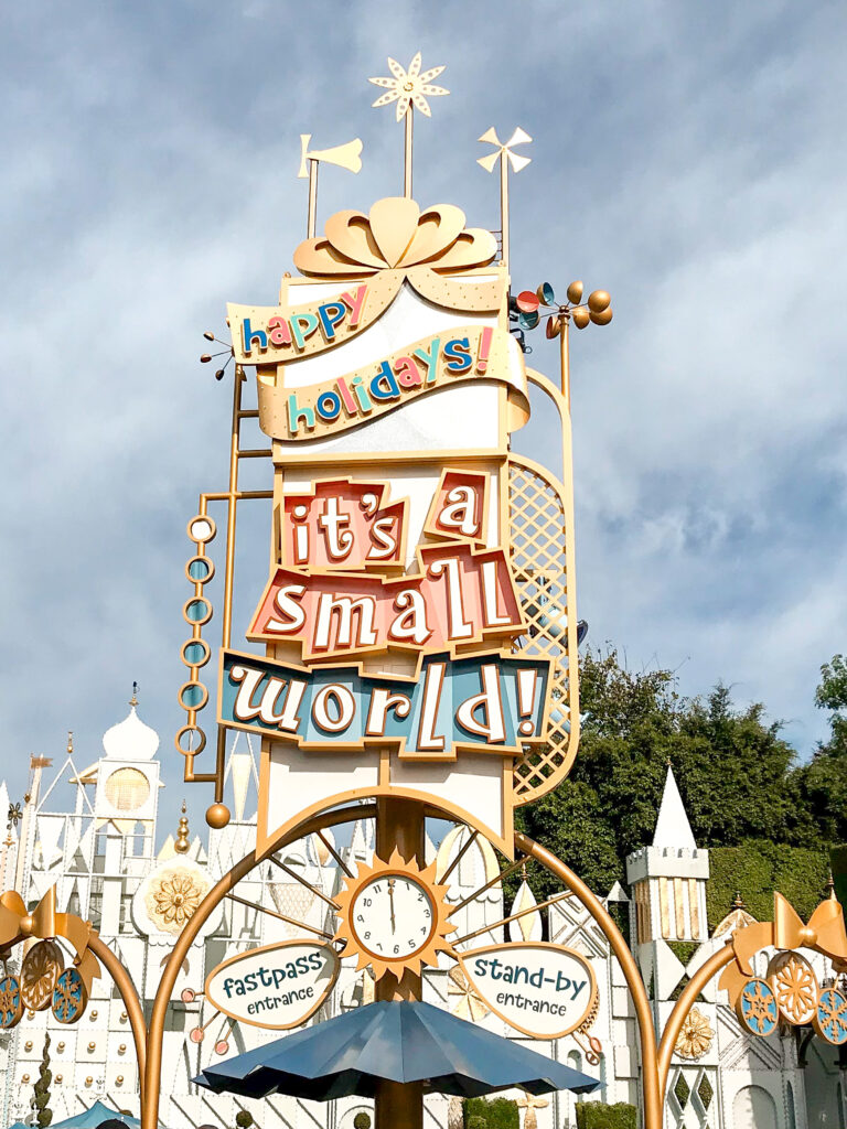 """Entrance sign for """"it's a small world"""" Holiday."""