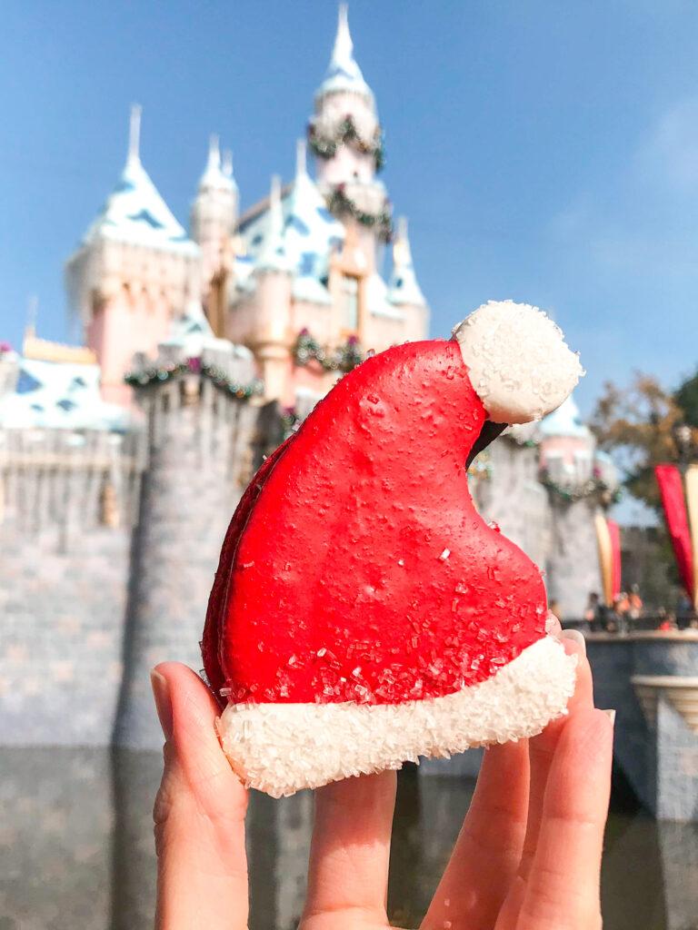 Santa Hat Macaron in front of Sleeping Beauty Castle.